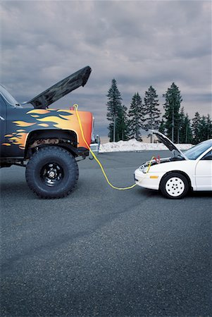 stalled car - Car Getting Boost from Truck Stock Photo - Rights-Managed, Code: 700-00551041