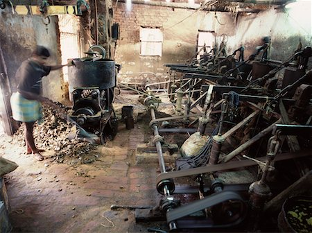Worker in a Mustard Seed Oil Factory, West Bengal, India Stock Photo - Rights-Managed, Code: 700-00551545