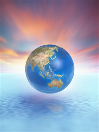 Globe Floating Above Water Stock Photo - Rights-Managed, Code: 700-00551550