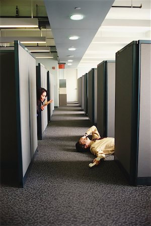 Man Passed Out on Office Floor Stock Photo - Rights-Managed, Code: 700-00551671