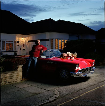 Couple in Driveway with Car Stock Photo - Rights-Managed, Code: 700-00592599