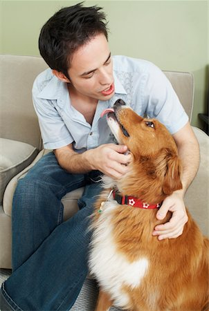 dog kissing man - Young Man Talking To Dog Stock Photo - Rights-Managed, Code: 700-00592746