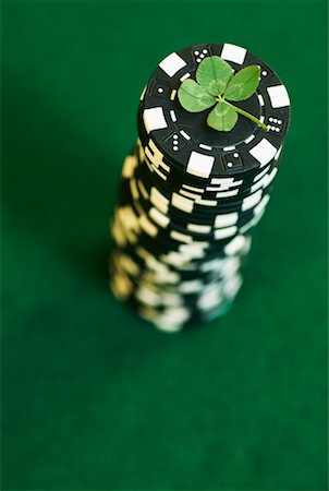 pile leaves playing - Four-Leaf Clover On Stack of Poker Chips Stock Photo - Rights-Managed, Code: 700-00592805