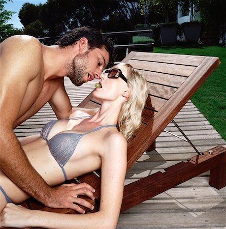 Couple Lying on Deck Chair Stock Photo - Rights-Managed, Code: 700-00605009