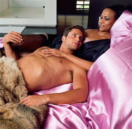 Couple Lounging In Bed Stock Photo - Rights-Managed, Code: 700-00606408