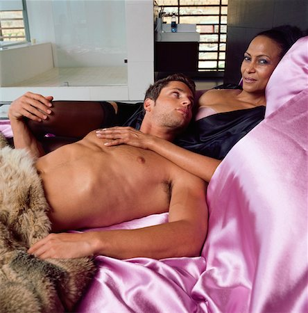 Couple Lounging In Bed Stock Photo - Rights-Managed, Code: 700-00606409