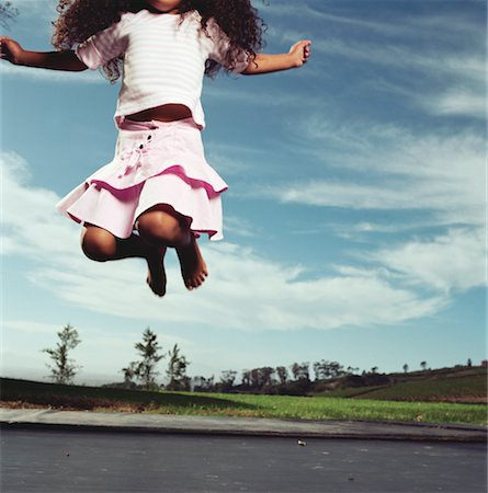 preteen girl feet - Girl Jumping on Trampoline Stock Photo - Rights-Managed, Code: 700-00606701