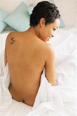Woman Sitting in Bed Stock Photo - Rights-Managed, Code: 700-00606805