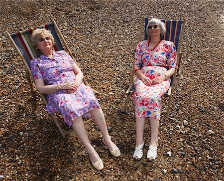 sleepy old woman - Two Women Sitting in Beach Chairs Stock Photo - Rights-Managed, Code: 700-00607077
