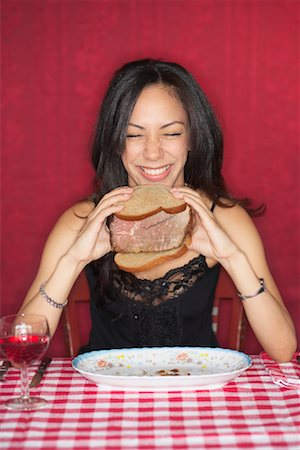 Woman Holding Beef Sandwich Stock Photo - Rights-Managed, Code: 700-00603398