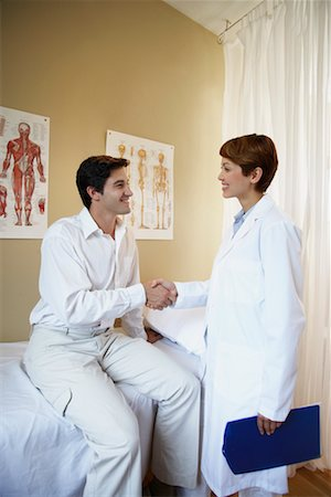 Doctor and Patient Shaking Hands in Doctor's Office Stock Photo - Rights-Managed, Code: 700-00616587