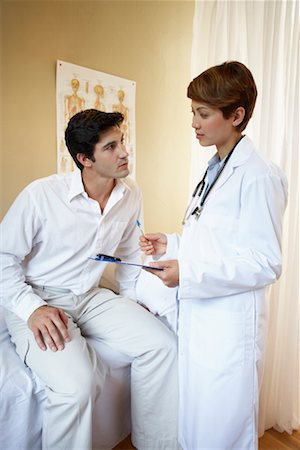 Doctor and Patient Talking Stock Photo - Rights-Managed, Code: 700-00616589