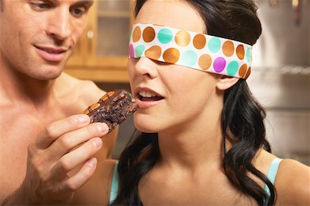 sexy couple chocolate - Man Feeding Blindfolded Woman a Brownie Stock Photo - Rights-Managed, Code: 700-00616754