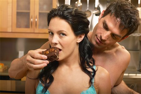 sexy couple chocolate - Man Feeding Woman Brownie Stock Photo - Rights-Managed, Code: 700-00616756