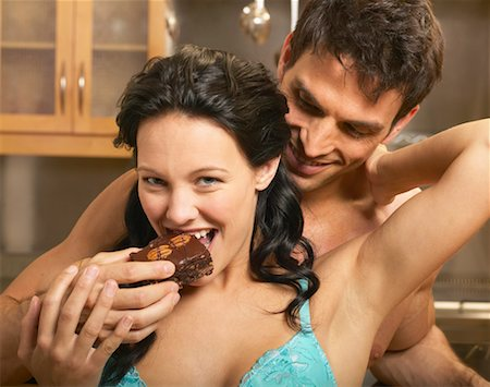 sexy couple chocolate - Man Feeding Woman Brownie Stock Photo - Rights-Managed, Code: 700-00616757