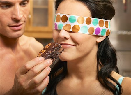sexy couple chocolate - Man Feeding Blindfolded Woman a Brownie Stock Photo - Rights-Managed, Code: 700-00616753