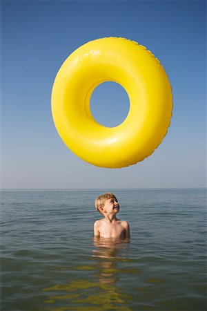pre-teen boy models - Boy in Water with Inner Tube Stock Photo - Rights-Managed, Code: 700-00617040