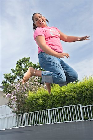 preteen girl feet - Girl Jumping on Trampoline Stock Photo - Rights-Managed, Code: 700-00617143