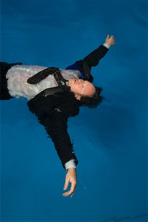 dead body floating in water - Businessman Floating in Swimming Pool Stock Photo - Rights-Managed, Code: 700-00617800