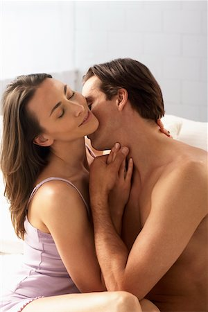 Couple Embracing on Bed Stock Photo - Rights-Managed, Code: 700-00610005
