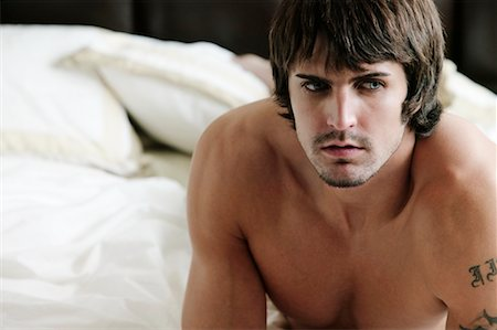 Portrait Of Nude Man In Bed Stock Photo - Rights-Managed, Code: 700-00610483