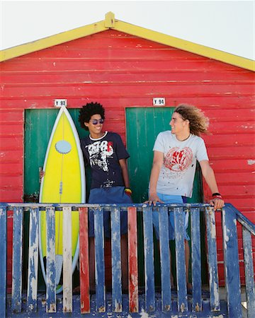 Friends by Beach Hut with Surfboard Stock Photo - Rights-Managed, Code: 700-00623338