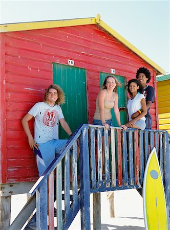 Friends by Beach Hut with Surfboard Stock Photo - Rights-Managed, Code: 700-00623340
