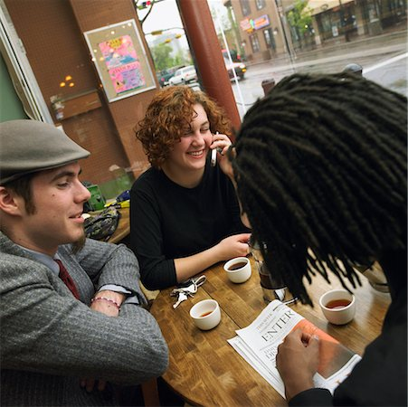Three Young People Having Tea At A Cafe Stock Photo - Rights-Managed, Code: 700-00634100