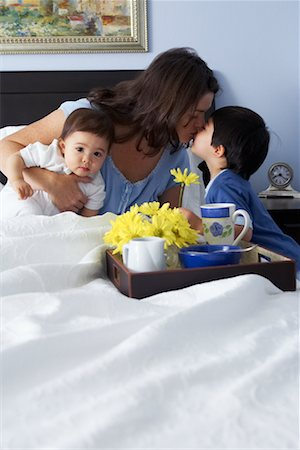 daughter kissing mother - Boy Bringing Mother Breakfast in Bed Stock Photo - Rights-Managed, Code: 700-00635523