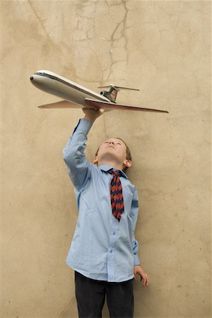 Boy Playing With Toy Airplane Stock Photo - Rights-Managed, Code: 700-00635836