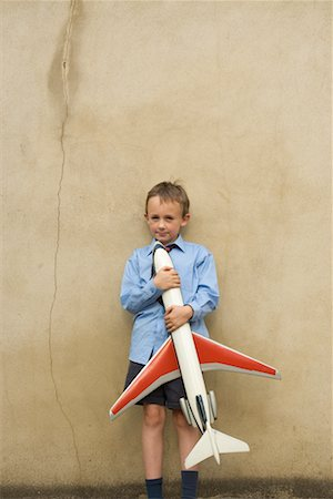 Boy Holding Toy Airplane Stock Photo - Rights-Managed, Code: 700-00635837