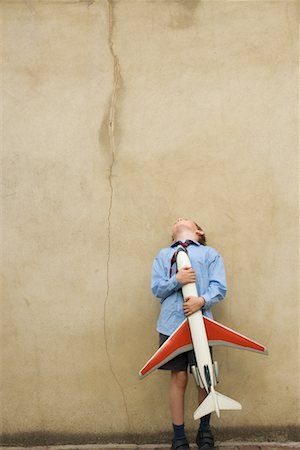 pre-teen boy models - Boy Playing With Toy Airplane Stock Photo - Rights-Managed, Code: 700-00635838