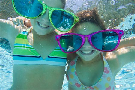 Two Girls Wearing Giant Sunglasses Underwater Stock Photo - Rights-Managed, Code: 700-00644302