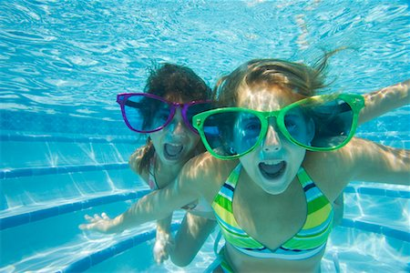 Two Girls Wearing Giant Sunglasses Underwater Stock Photo - Rights-Managed, Code: 700-00644303