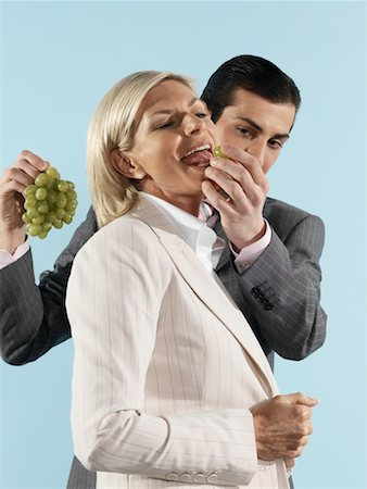 Businessman Feeding Grapes to Businesswoman Stock Photo - Rights-Managed, Code: 700-00659492