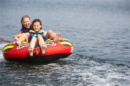 Two Girls Inner Tubing Stock Photo - Rights-Managed, Code: 700-00651342