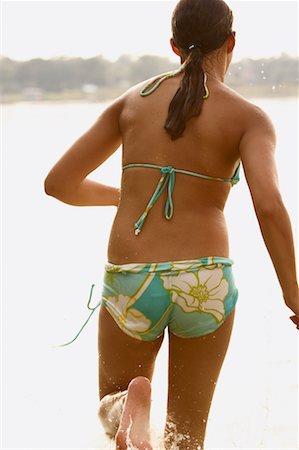 preteen girl feet - Girl Running on Beach Stock Photo - Rights-Managed, Code: 700-00651360