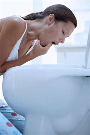 Woman Inducing Vomiting Stock Photo - Rights-Managed, Code: 700-00661134