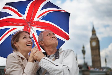 Couple Holding Umbrella, London, England Stock Photo - Rights-Managed, Code: 700-00661370
