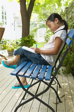 preteen thong - Girl Writing in Notepad on Bench Stock Photo - Rights-Managed, Code: 700-00686878