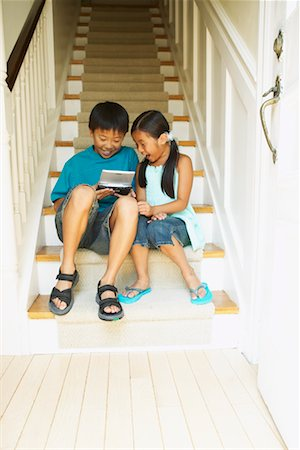 preteen thong - Boy and Girl with Handheld Video Game Stock Photo - Rights-Managed, Code: 700-00686902