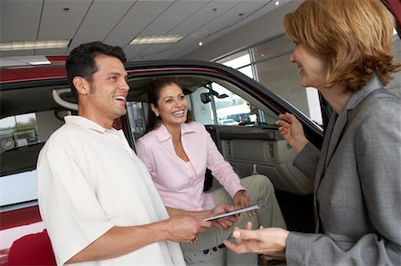female truck driver - Car Saleswoman Talking to Clients Stock Photo - Rights-Managed, Code: 700-00688473