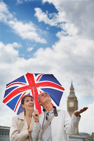 Tourists With Union Jack Umbrella Checking For Rain, London, England Stock Photo - Rights-Managed, Code: 700-00680919