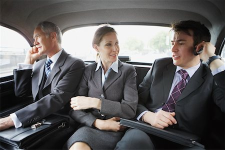 Business People Riding In the Back of A Cab Stock Photo - Rights-Managed, Code: 700-00680924