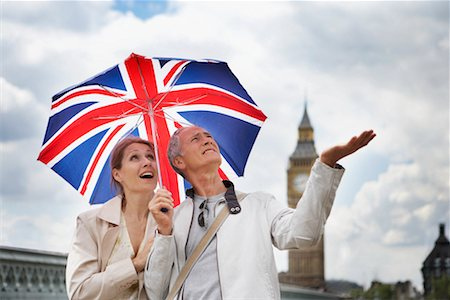 Tourists With Union Jack Umbrella Checking For Rain, London, England Stock Photo - Rights-Managed, Code: 700-00680920