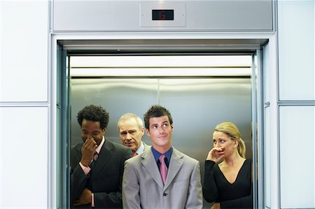 sweaty businessman - Business People on Elevator Smelling Unpleasant Odor Stock Photo - Rights-Managed, Code: 700-00681396