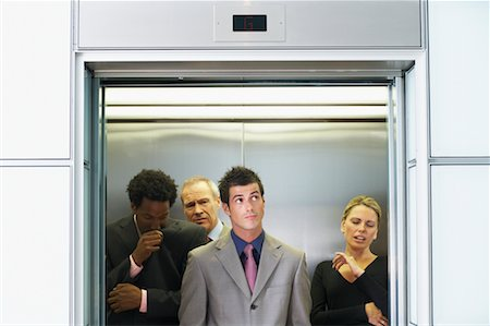 sweaty businessman - Business People on Elevator Smelling Unpleasant Odor Stock Photo - Rights-Managed, Code: 700-00681397