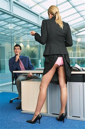 Businesswoman Standing at Businessman's Desk Stock Photo - Rights-Managed, Code: 700-00681417
