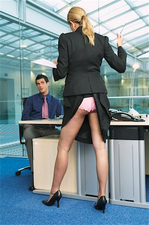 Businesswoman Standing at Businessman's Desk Stock Photo - Rights-Managed, Code: 700-00681418