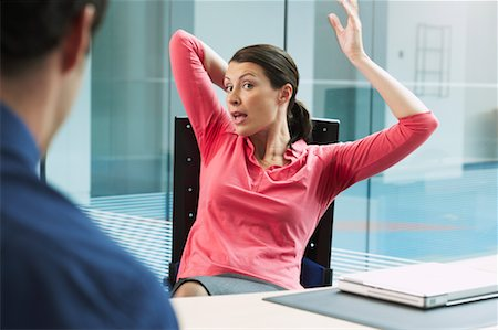 sweaty businessman - Businesswoman with Underarm Perspiration Marks, Sitting at Desk Stock Photo - Rights-Managed, Code: 700-00681412
